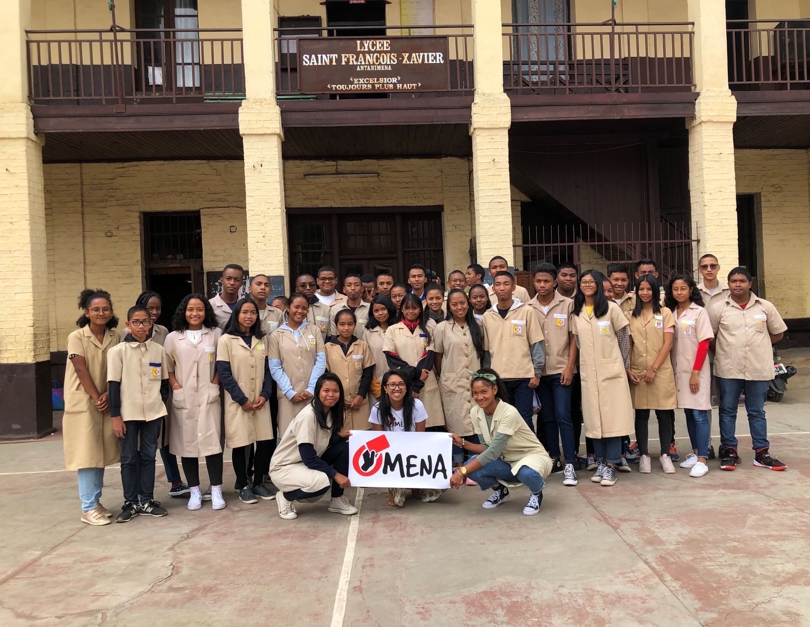 Group of high school student dressed in brown uniform with Omena logo